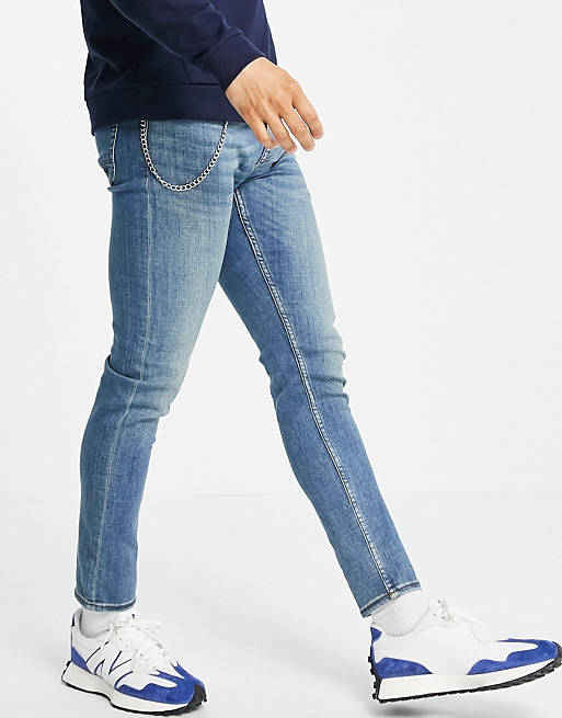skinny jeans with chain in mid washed blue, 1 of 4